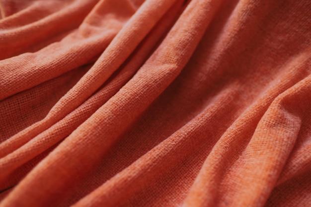 Tekstura tło z ciepłej tkaniny pomarańczowy.