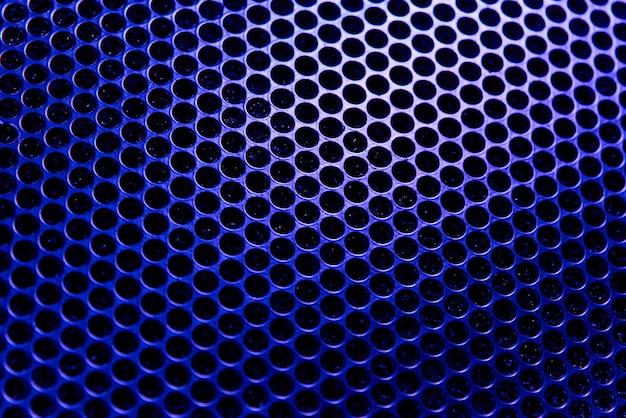 Tekstura tło z niebieskiej kraty w podświetlenie.