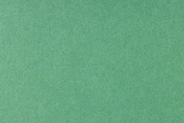 Tekstura tło zielony papier drukowany offsetowy. makro z bliska. pełna ramka