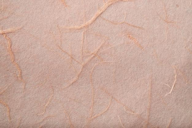 Tekstura tradycyjnego ręcznie czerpanego papieru morwy