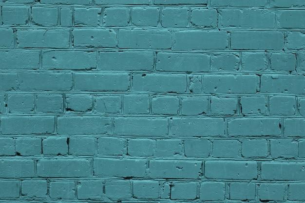 Tekstura turkusowy ściana z cegieł. zielone tło kamień.