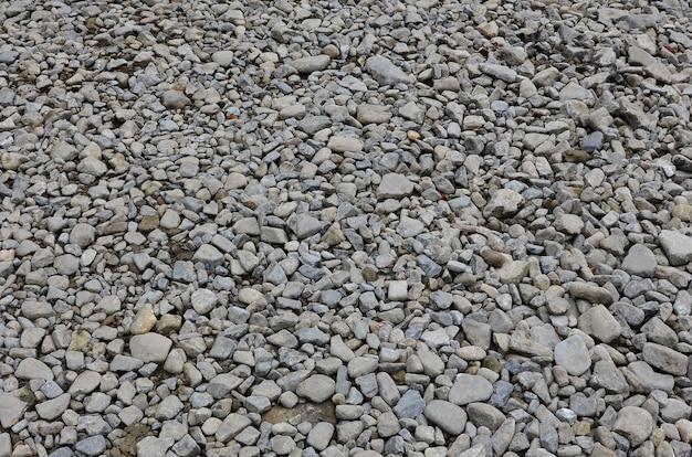 Tekstura wielu zgniecionych kamieni. kruszony kamień jest solidnym materiałem podstawowym do fundamentów