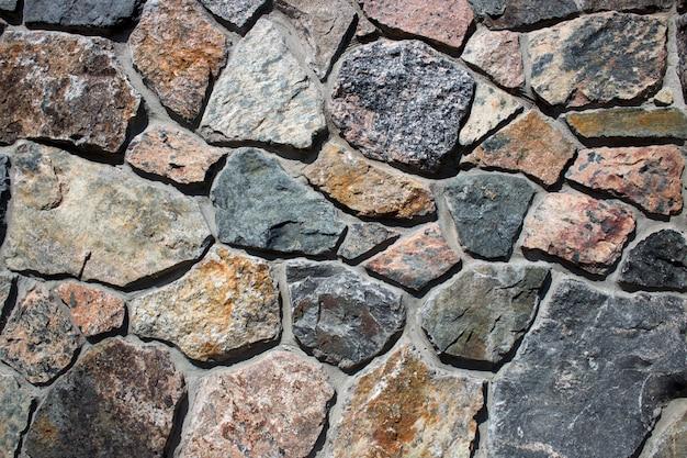 Tekstura wyłożona kamieniem naturalnym. tło dla projektantów