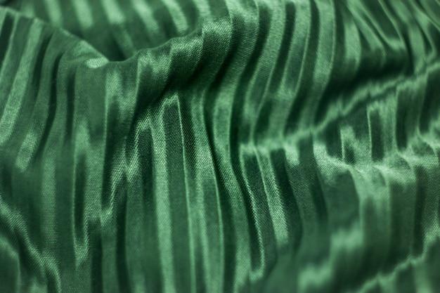 Tekstura, wzór, jedwabna tkanina w kolorze zielonym. zielony jedwab.
