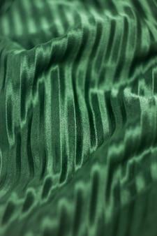 Tekstura, wzór, jedwabna tkanina w kolorze zielonym