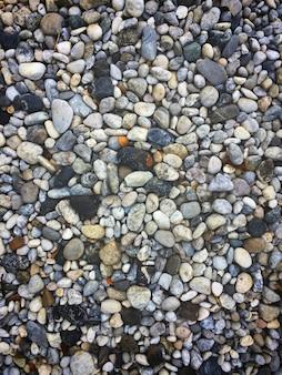 Tekstura wzór otoczaków żwir i mali kamienie w spacer sposobu ścieżce dla ogrodowego wnętrza de