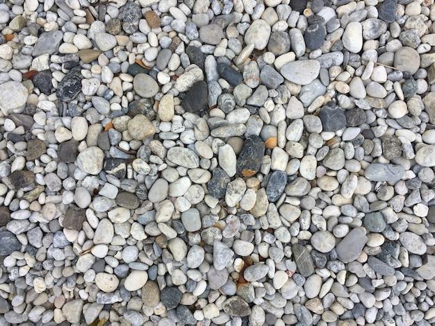Tekstura wzór otoczaków żwir i mali kamienie w spacer sposobu ścieżce dla ogródu