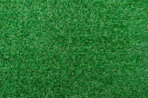 Tekstura zielona trawa widok z góry zielony trawnik. idealny golf lub piłka nożna, tło boisko do piłki nożnej