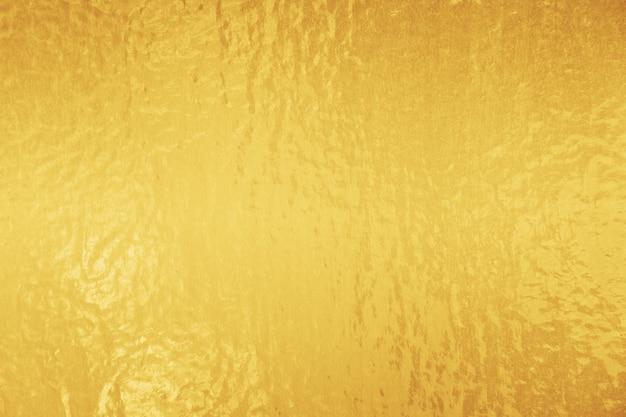 Tekstura złotej błyszczącej folii
