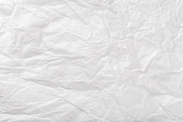 Tekstura zmięty biały opakunkowy papier, stary tło