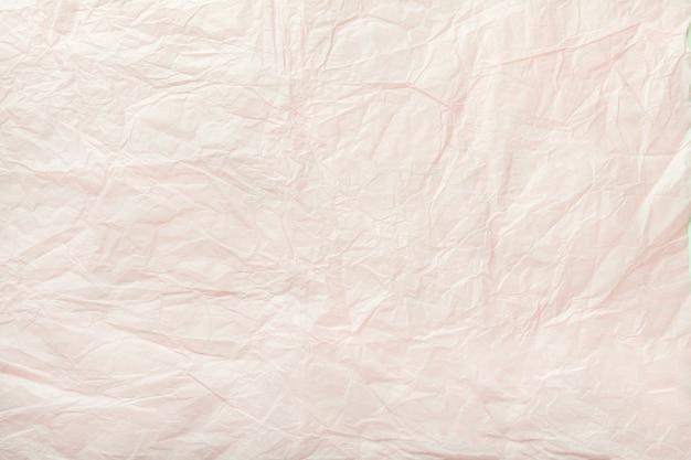 Tekstura zmięty biały opakunkowy papier, zbliżenie.