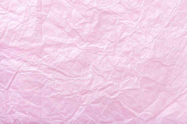 Tekstura zmięty różowy opakunkowy papier, zbliżenie