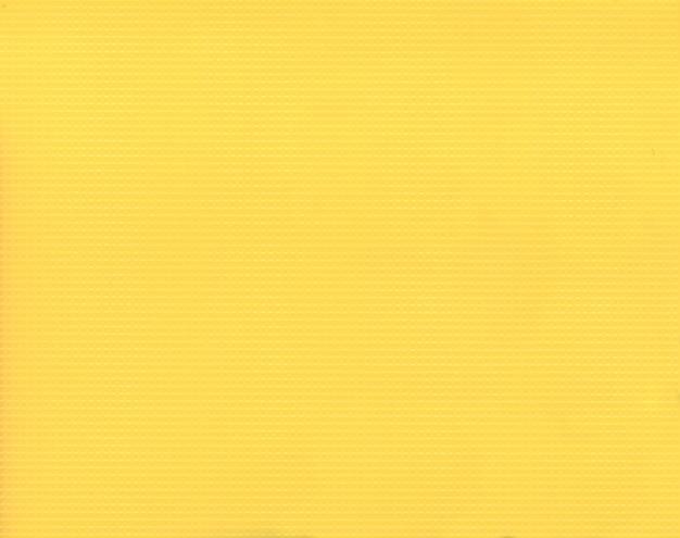 Tekstura żółte tło z tworzywa sztucznego falistej