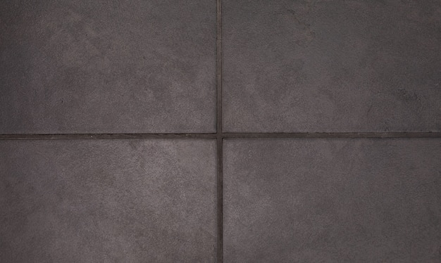 Teksturę tła z teksturą kwadratowych płytek ceramicznych podłogowych.