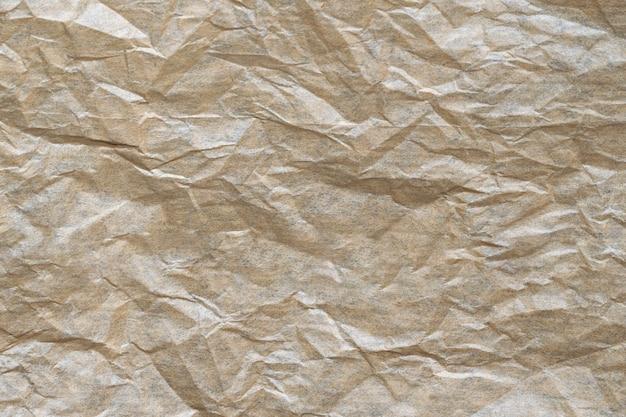 Teksturowana powierzchnia starego i pomarszczonego papieru.