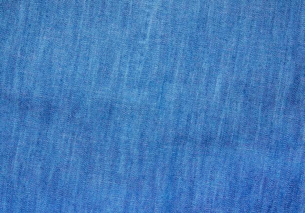 Teksturowana powierzchnia tkaniny denimowej w niebieskim kolorze