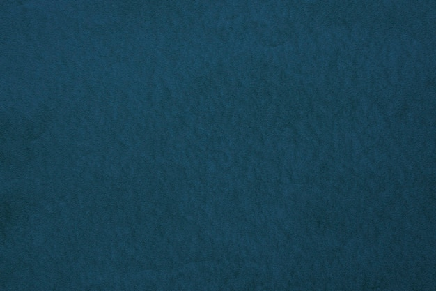 Teksturowane ciemnoniebieskie tło tekstury papieru