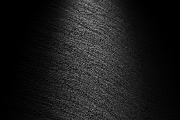 Teksturowane czarne tło łupkowe z plamką światła