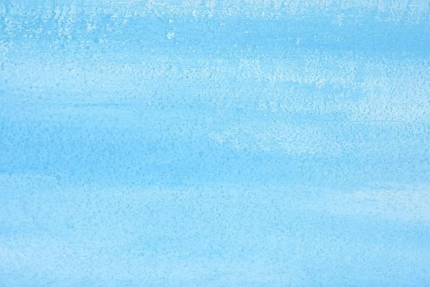 Teksturowane niebieskie tło z białymi smugami