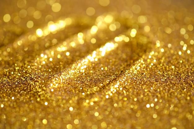 Teksturowane tło abstrakcyjne brokat złoty i elegancki