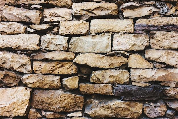 Teksturowane tło ściany z piaskowca