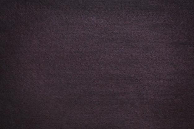 Teksturowane tło z ciemnobrązowego filcu z winietą