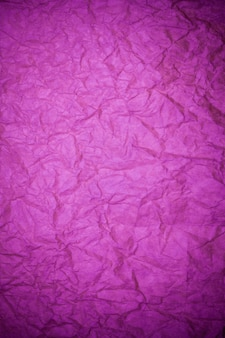 Teksturowanego papieru fioletowe tło.