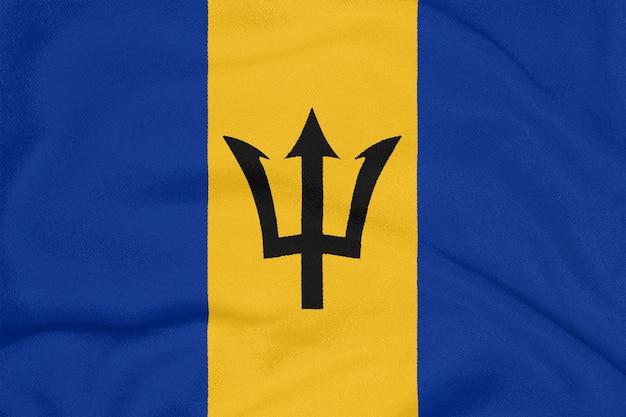 Teksturowany materiał z flagą barbadosu. symbol patriotyczny