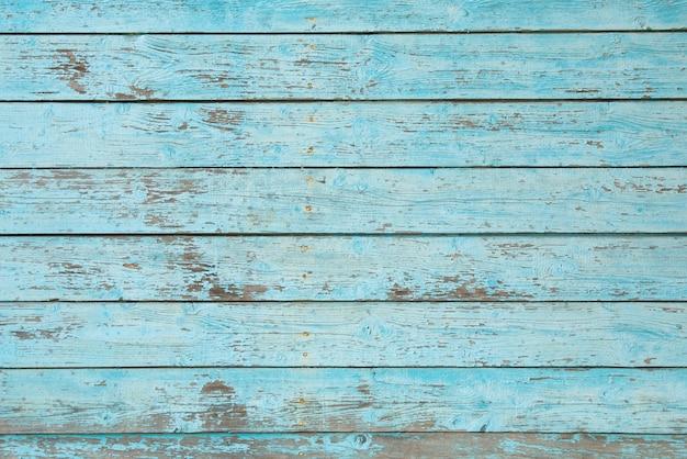 Tekstury drewniany tło z starą krakingową błękitną farbą