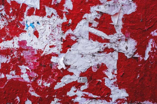 Tekstury grunge tło betonowa kamienna ściana z obieranie farbą czerwony kolor