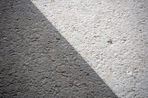 Tekstury i wzory szarych szorstkich podłóg w czerni i bieli.