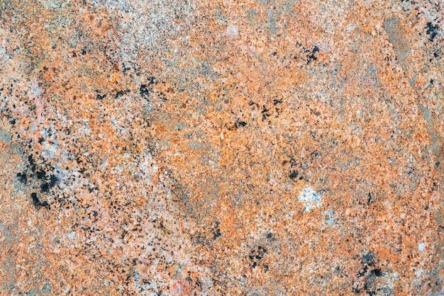 Tekstury kamienia. różowa powierzchnia granitu.