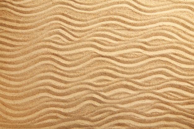 Tekstury piasku. piaszczysta plaża na tle. widok z góry