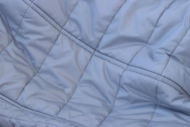 Tekstury pojęcie - zamyka up zmięty popielaty srebny tkaniny tło