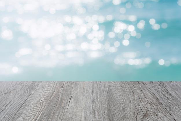 Tekstury powierzchni drewniane i błyszczące ośmiokątne bokeh.