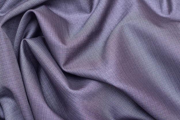Tekstury tła z tkaniny garniturowej, szare w małym kwadracie.