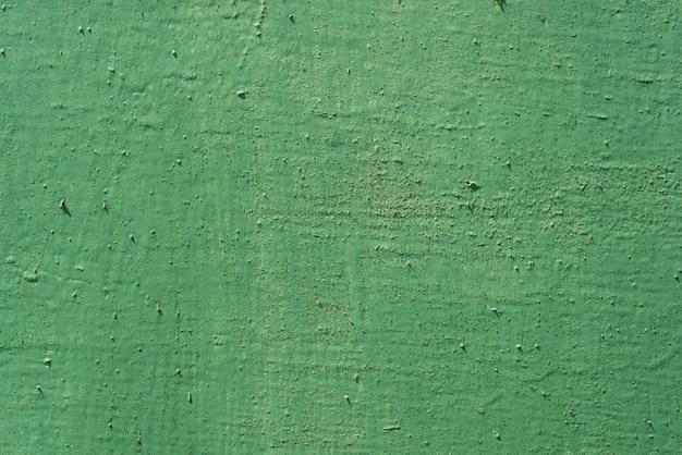 Tekstury tła zieleń malująca pękająca żelazo powierzchnia