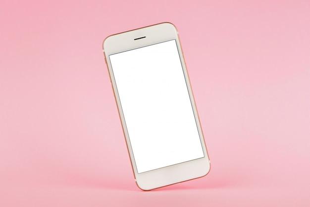 Telefon komórkowy na różowym pastelowym tle, technologia i biznes