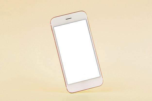 Telefon komórkowy na żółtym pastelu, technologii i biznesie