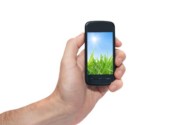 Telefon komórkowy w dłoni na białym tle