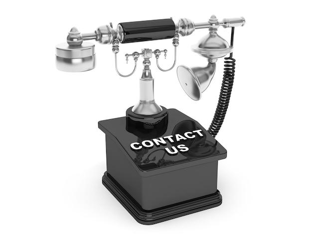 Telefon retro. vintage telefon z napisem skontaktuj się z nami na białym tle