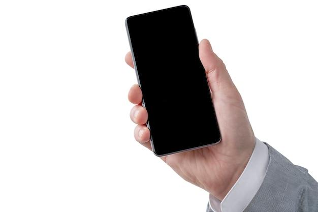 Telefon w ręce odizolowane biznesmena