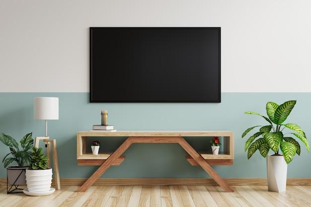 Telewizor na ścianie w salonie, ozdobiony szafką rtv z lampką i doniczkami na drewnianej podłodze