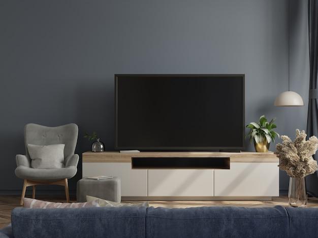 Telewizor na szafce w nowoczesnym pustym pokoju z ciemną ścianą. renderowanie 3d