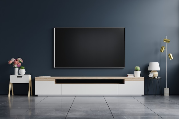 Telewizor na szafce w nowoczesnym pustym pokoju z ciemnoniebieską ścianą. renderowanie 3d