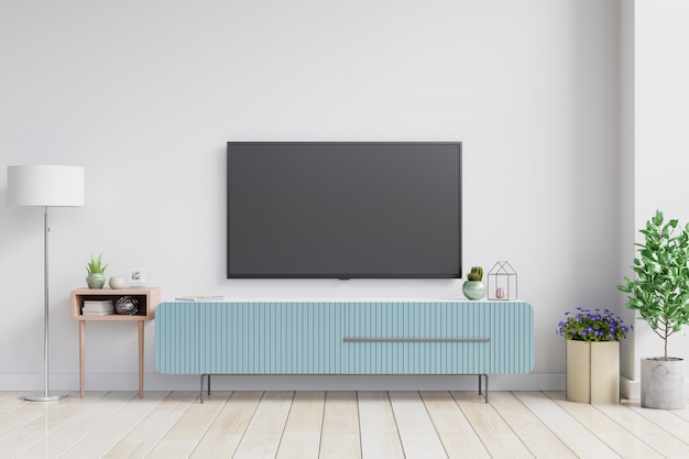 Telewizor na szafce w nowoczesnym salonie na białej ścianie