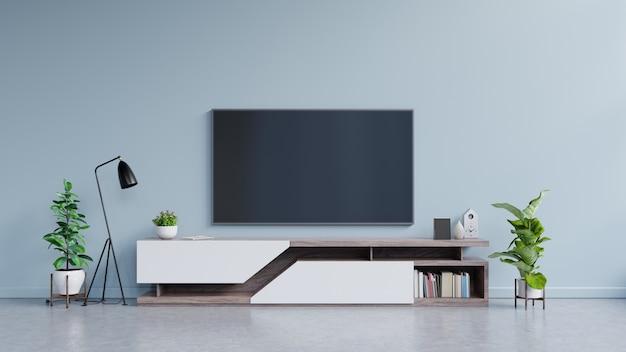 Telewizor na szafce w nowoczesnym salonie na niebieskiej ścianie.