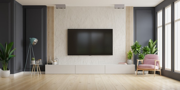 Telewizor na szafce w nowoczesnym salonie z fotelem, lampą, stołem, kwiatem i rośliną na ścianie gipsowej, renderowanie 3d