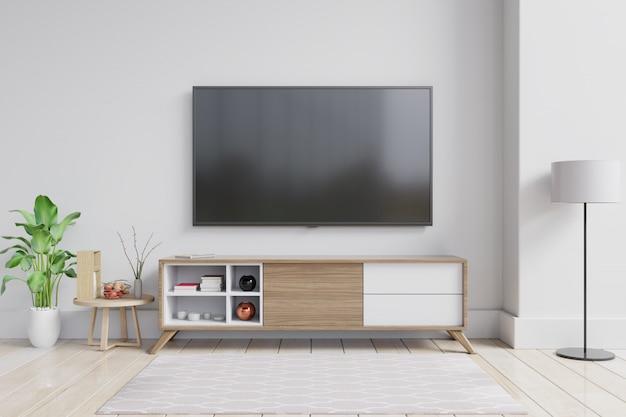Telewizor na szafce w nowoczesnym salonie z rośliną na białej ścianie