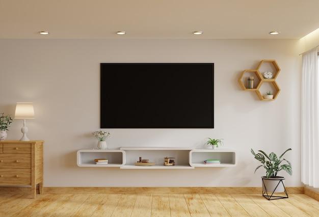 Telewizor w salonie na białej ścianie przy oknie, ozdobiony roślinami. renderowanie 3d.